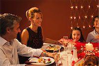 family table eating together - Family having Christmas dinner Stock Photo - Premium Royalty-Freenull, Code: 632-06404353