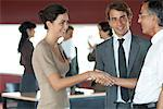 Colleagues shaking hands in office Stock Photo - Premium Royalty-Free, Artist: Blend Images, Code: 632-06404434