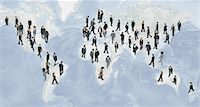 Large group of businesspeople walking on world map Stock Photo - Premium Royalty-Freenull, Code: 632-06404695
