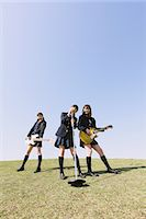 Japanese schoolgirls with musical instruments on a hill Stock Photo - Premium Rights-Managednull, Code: 859-06404862