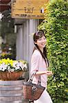 Japanese woman with her bag walking while looking at camera Stock Photo - Premium Rights-Managed, Artist: Aflo Relax, Code: 859-06404874