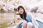 Japanese woman on a rowing boat with cherry blossoms in the background Stock Photo - Premium Rights-Managed, Artist: Aflo Relax, Code: 859-06404875