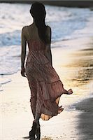 Japanese woman in a long dress walking away at the beach Stock Photo - Premium Rights-Managednull, Code: 859-06404895