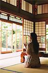 Japanese woman drinking green tea in a traditional Japanese house Stock Photo - Premium Rights-Managed, Artist: Aflo Relax, Code: 859-06404901