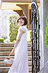 Japanese woman in a white dress with a basket standing near a gate Stock Photo - Premium Rights-Managed, Artist: Aflo Relax, Code: 859-06404958