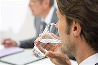 drinking water glass - Businessman sipping water in meeting, close up Stock Photo - Premium Royalty-Freenull, Code: 618-06405563