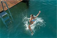 Girl falling into sea, high angle view Stock Photo - Premium Royalty-Freenull, Code: 618-06405667