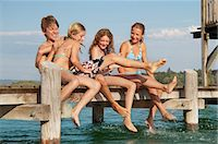 Young friends playing on pier Stock Photo - Premium Royalty-Freenull, Code: 618-06405668