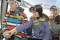 Girl pointing to friends in cable car on ski slope Stock Photo - Premium Royalty-Freenull, Code: 618-06405952