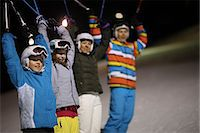 Boys and girls on ski slope holding ski poles at night Stock Photo - Premium Royalty-Freenull, Code: 618-06405997