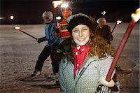 Girl holding flaming torch on ski slope at night, portrait Stock Photo - Premium Royalty-Freenull, Code: 618-06406000