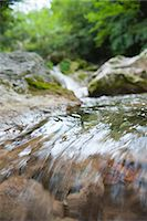 streaming - Water flowing over rocks, close-up Stock Photo - Premium Royalty-Freenull, Code: 633-06406425