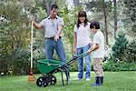 Father and two children working together in yard Stock Photo - Premium Royalty-Free, Artist: Norbert Schäfer, Code: 633-06406543