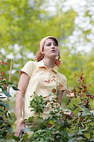 Young woman pruning roses in garden Stock Photo - Premium Royalty-Freenull, Code: 633-06406801