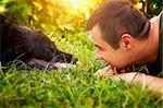 Friends concept. Man and labrador retirever dog are lying in summer grass Stock Photo - Royalty-Free, Artist: mythja                        , Code: 400-06408283