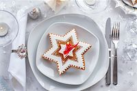 Plate for Christmas evening decorated with small present and gingerbread cookie Stock Photo - Royalty-Freenull, Code: 400-06416325