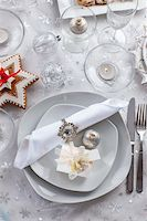 Plate for Christmas evening decorated with small present and gingerbread cookie Stock Photo - Royalty-Freenull, Code: 400-06416326