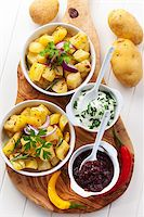 Baked potatoes with chutney and sour cream - top view Stock Photo - Royalty-Freenull, Code: 400-06416343