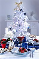 Place setting for Christmas in white and blue with the tree Stock Photo - Royalty-Freenull, Code: 400-06416371