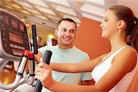sweaty woman - Portrait of pretty girl training in gym with her trainer near by Stock Photo - Royalty-Freenull, Code: 400-06417282