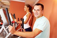 sweaty woman - Portrait of young man training on special sport equipment in gym and looking at camera Stock Photo - Royalty-Freenull, Code: 400-06417284