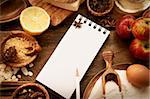 Baking concept background with paper for notes. Christmas and winter  cookies ingredients.Baking pastry and cookies: apples, spices, sugar, eggs on wood Stock Photo - Royalty-Free, Artist: mythja                        , Code: 400-06418661