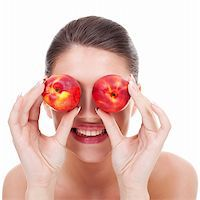 Young happy woman with red peaches over her eyes on white background Stock Photo - Royalty-Freenull, Code: 400-06419166