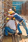 Authentic construction builders working together for positioning concrete formwork frames in place Stock Photo - Royalty-Free, Artist: akarelias                     , Code: 400-06419638