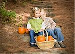 Adorable Brother and Sister Children Sitting on Wood Steps with Pumpkins Whispering Secrets or Kissing Cheek. Stock Photo - Royalty-Free, Artist: Feverpitched                  , Code: 400-06420862
