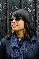 Young Asian woman wearing sunglasses portrait, dark background Stock Photo - Royalty-Freenull, Code: 400-06424643