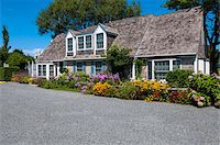 quaint house - Exterior of House with Colorful Flower Garden, Provincetown, Cape Cod, Massachusetts, USA Stock Photo - Premium Rights-Managednull, Code: 700-06431219