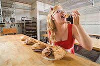 Woman Wearing Devil Horns at a Bakery, Oakland, Alameda County, California, USA Stock Photo - Premium Royalty-Freenull, Code: 600-06431349