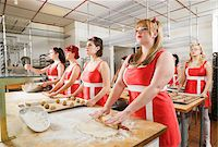 funny looking people - Women Wearing Devil Horns Working at a Bakery, Oakland, Alameda County, California, USA Stock Photo - Premium Royalty-Freenull, Code: 600-06431354