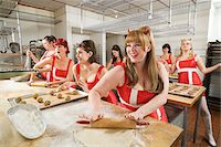 Women Wearing Devil Horns Working at a Bakery, Oakland, Alameda County, California, USA Stock Photo - Premium Royalty-Freenull, Code: 600-06431355