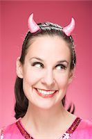 Portrait of Woman Wearing Devil Horns and Smiling Stock Photo - Premium Royalty-Freenull, Code: 600-06431378
