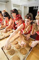Women Wearing Devil Horns at a Bakery, Oakland, Alameda County, California, USA Stock Photo - Premium Royalty-Freenull, Code: 600-06431390