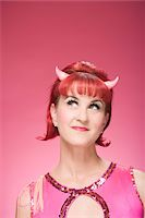 funny pose - Portrait of Woman Wearing Devil Horns Stock Photo - Premium Royalty-Freenull, Code: 600-06431406