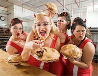 Women Wearing Devil Horns at a Bakery, Oakland, Alameda County, California, USA Stock Photo - Premium Royalty-Freenull, Code: 600-06431434