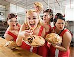 Women Wearing Devil Horns at a Bakery, Oakland, Alameda County, California, USA Stock Photo - Premium Royalty-Free, Artist: Mitch Tobias, Code: 600-06431434