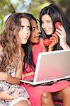Women using laptop and phone whilst sitting on a tree branch Stock Photo - Premium Royalty-Free, Artist: Ty Milford, Code: 649-06432351