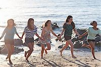 Women holding hands on beach Stock Photo - Premium Royalty-Freenull, Code: 649-06432371
