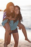 Woman carrying friend on beach Stock Photo - Premium Royalty-Freenull, Code: 649-06432382