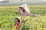 Sisters playing in field of flowers Stock Photo - Premium Royalty-Free, Artist: Ben Seelt, Code: 649-06432417