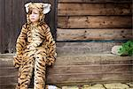 Boy wearing tiger costume outdoors Stock Photo - Premium Royalty-Free, Artist: Minden Pictures, Code: 649-06432487