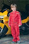 Boy wearing race car driver costume Stock Photo - Premium Royalty-Free, Artist: Blend Images, Code: 649-06432499