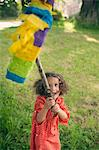 Girl swinging at pinata at party Stock Photo - Premium Royalty-Free, Artist: ableimages, Code: 649-06432519