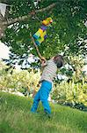 Boy swinging at pinata at party Stock Photo - Premium Royalty-Free, Artist: Aflo Sport, Code: 649-06432522