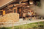 Man reading in porch of log cabin Stock Photo - Premium Royalty-Free, Artist: Westend61, Code: 649-06432609