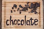 Chocolate written on cutting board Stock Photo - Premium Royalty-Free, Artist: Michael Mahovlich, Code: 649-06432649