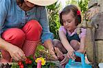 Mother and daughter gardening together Stock Photo - Premium Royalty-Free, Artist: Blend Images, Code: 649-06432654